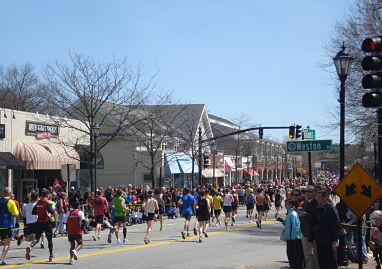 2011 boston marathon runners enter wellesley square