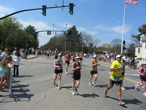 Boston Marathon runners enter Wellesley Square, 2012