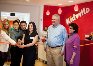 From left to right, The Mayor of Kidville Wellesley, Haley, owners Kuangshin Tai, Harvard Pan and Cathy Tai, town representative Don McCauley, and Wellesley Chamber of Commerce rep Maura O'Brien.