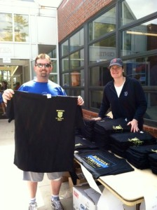 Lt. Cleary (right) with a T-shirt customer (photo by Jim Jones)