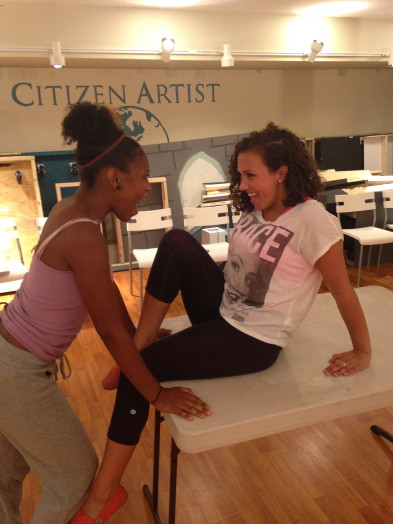 Joanne (Jayla Glover) and Maureen (Grace Migliozzi) rehearse the song Take Me or Leave Me from RENT.