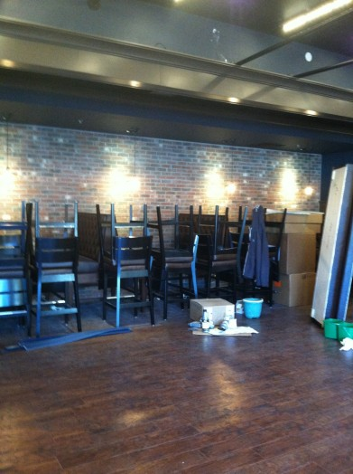 Dining area: Stacked tables and chairs, longing to receive hungry customers.