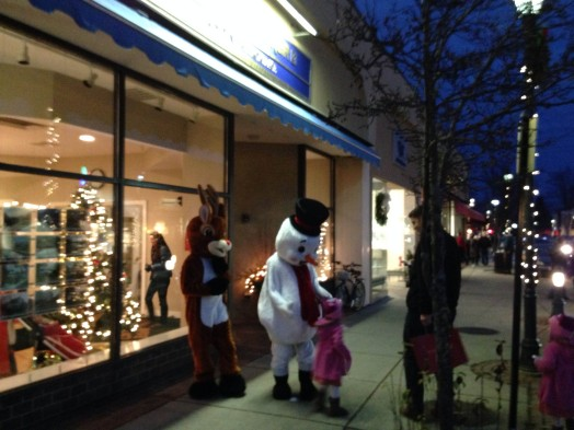 Rudolph & Frosty chat with a young friend in Wellesley Square