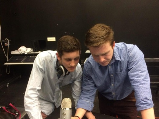 "Idan Waksman and Brian Kelly work to edit recordings as part of their work with the WMS a cappella group ""Clef Hangers."""