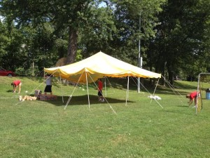 Wellesley High students set up for the barefoot soccer event