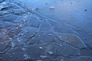 Coach Lou Grignaffini broke up the ice closest to the beach earlier in the morning
