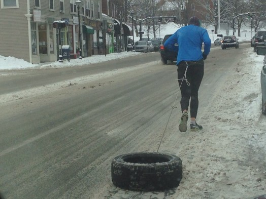 tire running guy wellesley square