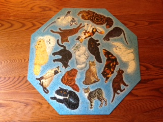 Vintage kitty puzzle, with only one piece missing, from Give and Take. We could get all Gallic frugal and use as a stand-in for a fine French linen placemat, I suppose.