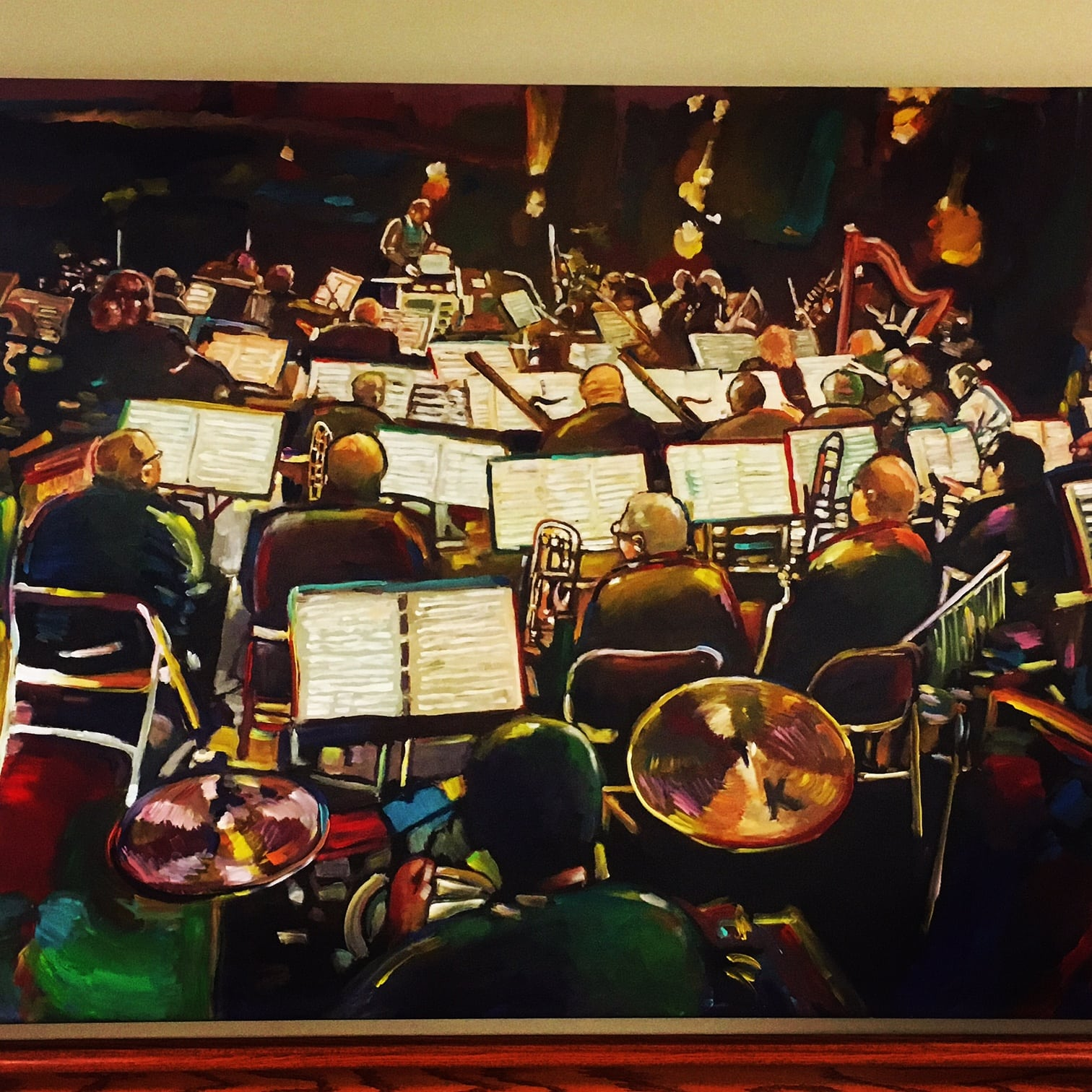 A different angle of the Wellesley Symphony Orchestra, this one by painter Howie Green, donated to Mass Bay by the artist.