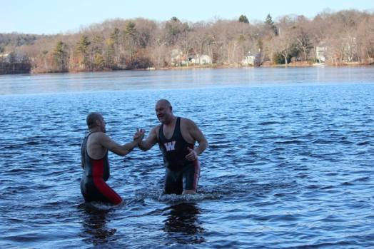 Lou Grignaffini and Mark Yanchewski were the last to leave the water during the first polar plunge on New Year's Day 2015 at Morses Pond. Photo credit: Jill Grignaffini.
