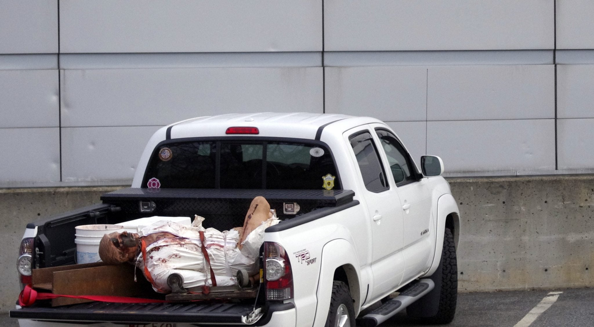 pickup with body in back of Wellesley Fire Station on Rte 9