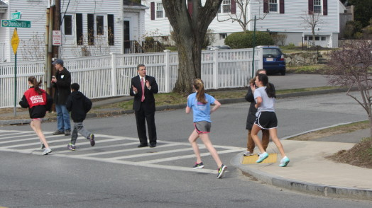 Wellesley School Superintendent David Lussier roots on mini-marathoners