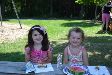 Taylor Thompson and Hadley Grover enjoy Wellesley Mothers Forum family picnic at Morses Pond