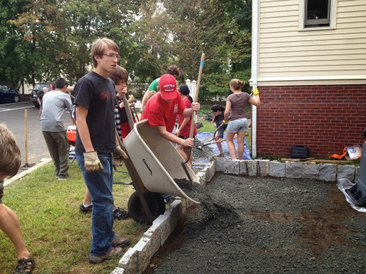 Wellesley's Max Sours (dark shirt) and friends building Zen Garden in Watertown