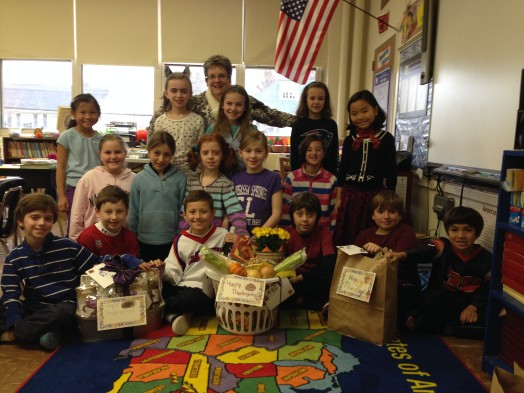 Third grade class with their Thanksgiving Basket for a family in need