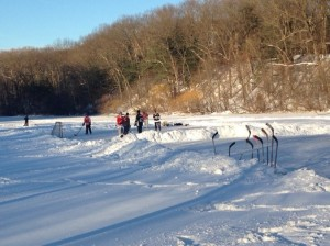 Skaters recently playing hockey on Longfellow Pond. Photo by Lucy Elway