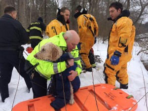 Wellesley fire/police make a dog rescue from Charles River. Photo via Wellesley Police