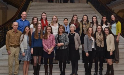 WHS's Champion Nordic Ski Team takes a turn on the grand staircase of the State House with Rep. Alice Peisch. Photo credit to Karen Polito.