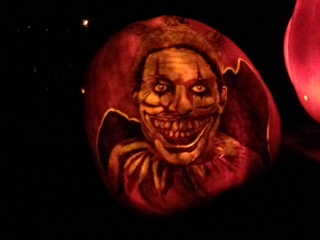 """In our never-ending effort to bring things back around to Wellesley, we think this pumpkin carving bears an eerie resemblance to """"Laughing Fool"""", a painting that hangs in the Davis Museum at Wellesley College."""