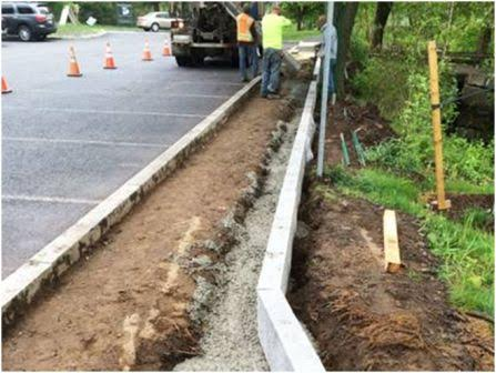 Installing granite curb for new path at State Street parking lot
