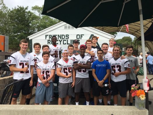 The WHS football team stopped by to help out the RDF volunteers with some heavy work. They weren't too busy to pose for a pic. I handed out a zinnia to each. Some wore them in their hair, some held them in their hands, or their teeth.