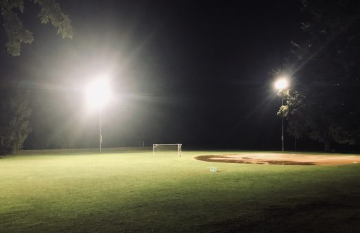 rainy field, lights on, hunnewell field