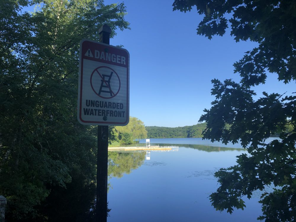 no lifeguards warning sign morses pond beach