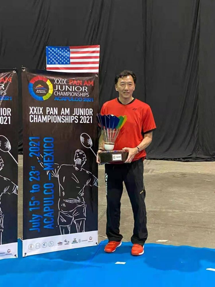 Andy Chong, head coach, leads the USA junior team to win gold medal in team event.